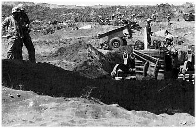 USMC Official Photo - HQ#11649; Bulldozer scoops out excavation for telephone exchange just behind front lines.